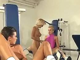Two dissolute lezzies caress and lick chick in the gym